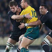 Quade Cooper is tackled by  Richie McCaw, (left) and Jerome Kaino  during the New Zealand V Australia Tri-Nations, Bledisloe Cup match at Eden Park, Auckland. New Zealand. 6th August 2011. Photo Tim Clayton