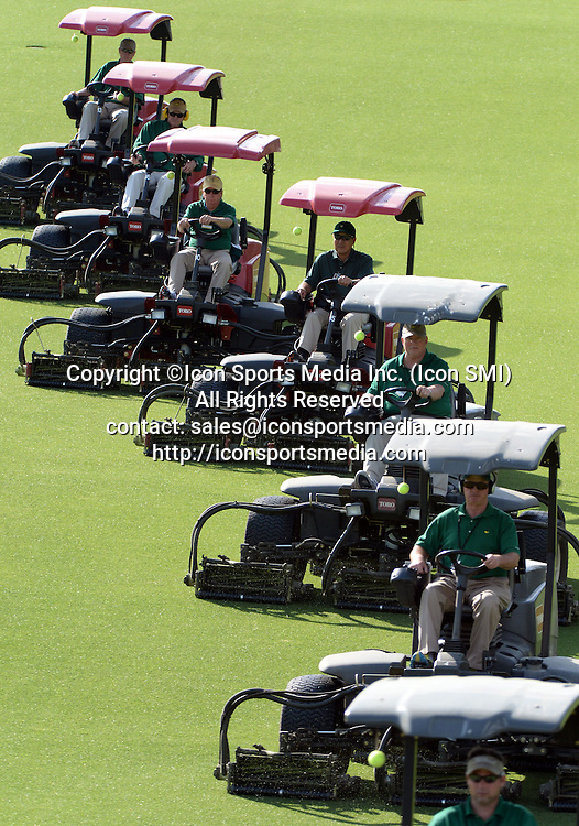 April 8, 2013 - Augusta, Georgia, U.S. - Mowers work on the 1 fairway during the first practice round of the 2013 Masters Tournament at Augusta National Golf Club on April 8, 2013, in Augusta, Ga.