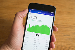 Detail of stock market performance of Facebook company on a smart phone