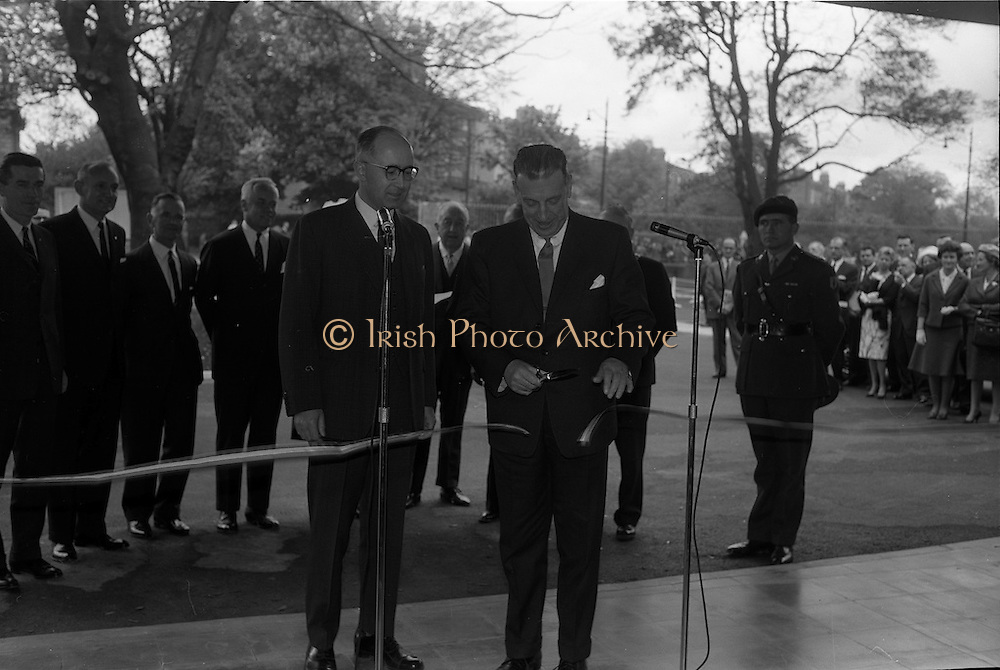 22/05/1963<br /> 05/22/1963<br /> 22 May 1963<br /> Opening of the Intercontinental Hotel, Pembroke Road, Ballsbridge, Dublin. The hotel was officially opened by An Taoiseach Mr. Sean Lemass. <br /> Image shows Taoiseach Sean Lemass cutting the tape to officially open the hotel. Alson in the picture is Mr. James Gorman, President Intercontinental Hotels (Ireland) Ltd. on left.