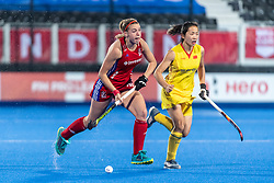 Lily Owsley of Great Britain Women goes past Xiao Sun of China Women during the 2019 Women's FIH Pro League match at Lee Valley Hockey Centre, Stratford<br /> Picture by Simon Parker/Focus Images Ltd <br /> 03/05/2019