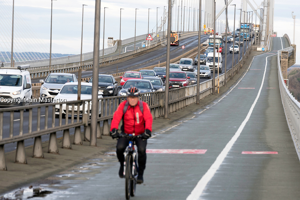South Queensferry, United Kingdom. 1 December, 2017. Southbound carriageway of new Queensferry Bridge is closed to allow emergency repairs to the carriageway. Southbound traffic from Fife is being diverted over the adjacent Forth Road Bridge, shown here, which has been opened temporarily to traffic. Remedial snagging work to the Queensferry Bridge is expected to take 10 months.