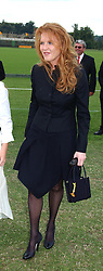 SARAH, DUCHESS OF YORK and her daughter PRINCESS BEATRICE at the Veuve Clicquot sponsored Gold Cup or the British Open Polo Championship won by The  Azzura polo team who beat The Dubai polo team 17-9 at Cowdray Park, West Sussex on 18th July 2004.