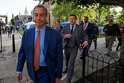 © Licensed to London News Pictures. 24/06/2016. London, UK. UKIP leader NIGEL FARAGE flanked by security in Westminster on the day that the UK voted to leave the EU in a referendum. Photo credit: Ben Cawthra/LNP