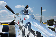 Few aircraft capture the essence of World War II combat aviation like the P-51 Mustang. This beautifully polished example reflects the sky and clouds.
