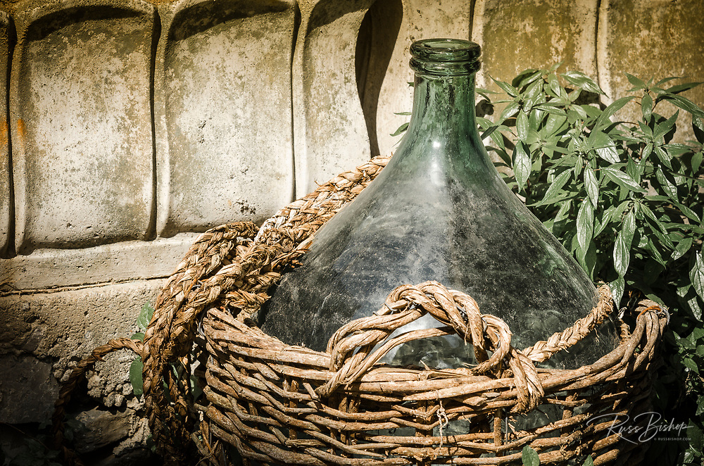 Traditional wine jug in a basket, Riomaggiore, Cinque Terre, Liguria, Italy