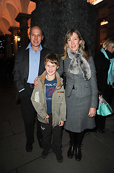 PEREGRINE & CAROLINE ARMSTRONG-JONES and their son ROBERT at a Winter Party given by Tiffany & Co. Europe to launch the 10th season of Somerset House's Ice Skating Rink at Somerset House, The  Strand, London on 16th November 2009.