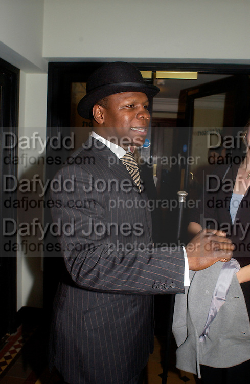 Chris Eubank, European premiere of Cirque de Soleil's Dralion, Royal Albert Hall and afterwards at the Natural History Museum, 8 January 2003.  .© Copyright Photograph by Dafydd Jones 66 Stockwell Park Rd. London SW9 0DA Tel 020 7733 0108 www.dafjones.com