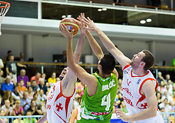 Tornike Shengelia of Georgia and Mikhail Chochua of Georgia vs Jure Balazic of Slovenia during friendly basketball match between National teams of Slovenia and Georgia in day 2 of Adecco Cup 2014, on July 25, 2014 in Dvorana OS 1, Murska Sobota, Slovenia. Photo by Vid Ponikvar / Sportida.com
