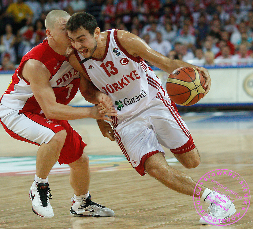 Wroclaw 09/09/2009.EuroBasket 2009.Preliminary Round - Group D.Poland v Turkey.Krzysztof Szubarga of Poland and Ender Arslan of Turkey ..Photo by : Piotr Hawalej / WROFOTO