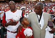 The Cincinnati Reds manager Dusty Baker, left along with his son Darren Baker 10 stand with Hank Aaron 2009 MLB Beacon Award winner for the National Anthem before the Cincinnati Reds Chicago White Sox Major League Baseball Gillette Civil Rights Game at Great American Ball Park Saturday June 20, 2009.