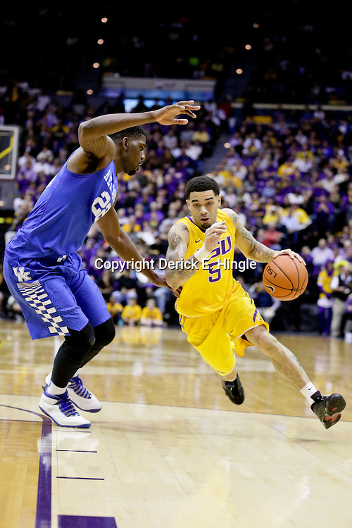 Jan 5, 2016; Baton Rouge, LA, USA; LSU Tigers guard Josh Gray (5) drives past Kentucky Wildcats forward Alex Poythress (22) during the first half of a game at the Pete Maravich Assembly Center. Mandatory Credit: Derick E. Hingle-USA TODAY Sports