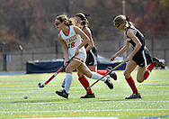 AMBLER, PA -  NOVEMBER 9: Gwynedd Mercy's Nicole Catalino (18) drives to the net on the way to scoring as she is chased by Archbisop Carroll defenders in the second half of a playoff field hockey game between Archbishop Carroll and Gwynedd Mercy Academy at Wissahickon High School November 9, 2013 in Ambler Pennsylvania. (Photo by William Thomas Cain/Cain Images)