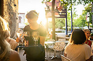 Outdoor dining in downtown Marquette, Michigan at Zephyr Wine Bar.