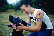 Gavin playing with dog, UK, 1980s.