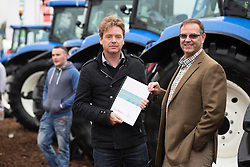Repro Free: 23/09/2014<br /> Report&rsquo;s author, economist and broadcaster, David McWilliams is pictured with John Warburton, CEO, DoneDeal at the National Ploughing Championships launching the first DoneDeal &lsquo;Tomorrow&rsquo;s Ireland&rsquo; Report, shining a particular light on the world of Irish Farming through the lens of DoneDeal&rsquo;s farming data. <br /> <br /> With over 21,200 unique farming adverts currently placed on DoneDeal and with goods to the value of &euro;20 million for sale in the farming section alone, farmers are buying and selling online like never before. Picture Andres Poveda