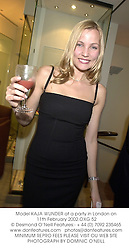 Model KAJA WUNDER at a party in London on 11th February 2002.	OXG 52