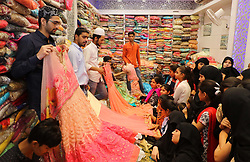 June 22, 2017 - Jaipur, Rajasthan, India - Indian Muslims  busy in shopping  at Ramganj Bazar ahead of Eid al-Fitr, during the holy month of Ramadan in Jaipur,Rajasthan, India, 22 June 2017. Muslims observe Eid-al-Fitr which marks the end of Ramadan. People prepare feasts, wear new clothes and apply Henna to celebrate the festival.(Photo By Vishal Bhatnagar/NurPhoto) (Credit Image: © Vishal Bhatnagar/NurPhoto via ZUMA Press)