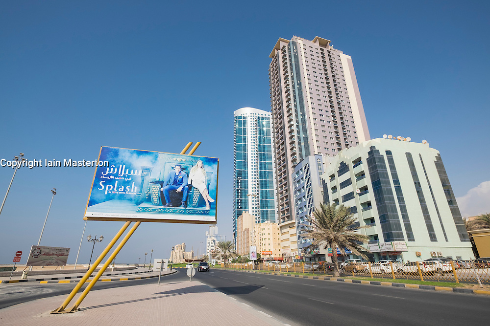 View of street and high-rise modern buildings on Corniche street in Ajman emirate in United Arab Emirates