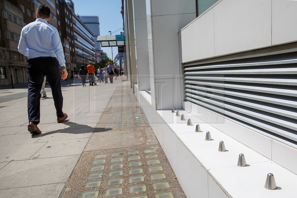 © Licensed to London News Pictures. 11/06/2015. London, UK. 'Anti-homeless spikes' outside Foxtons' Holborn branch in central London. An online petition to get them removed launched on Thursday, 11 June 2015 is rapidly gathering support and picked up more than 13,000 signatures in a matter of hours. Photo credit: Tolga Akmen/LNP