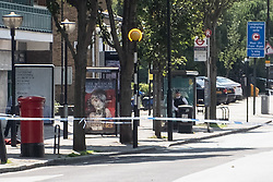 © Licensed to London News Pictures. 01/09/2018. London, UK. A police cordon is on place after incident involving woman in her 20s was stabbed in broad daylight on on Caledonian Road., north London. A man has been arrested on suspicion of attempted murder following the incident. Photo credit: Ray Tang/LNP