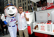 Former Mets first baseman Keith Hernandez acts as an honorary Good Humor Man, handing out frozen treats to fans with Mrs. Met, to officially kick off Good Humor's Welcome to Joyhood campaign, Thursday, June 25, 2015, in New York.  Follow @GoodHumor on Twitter as the Joy Squad travels to other cities this summer. (Photo by Diane Bondareff/AP Images for Good Humor)