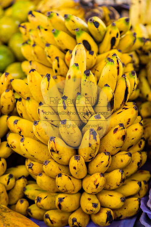 Bananas at a fresh fruit stand at the Sunday market in Tlacolula de Matamoros, Mexico. The regional street market draws thousands of sellers and shoppers from throughout the Valles Centrales de Oaxaca.