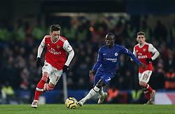 Mesut Ozil of Arsenal on the ball under pressure from Ngolo Kante of Chelsea - Mandatory by-line: Arron Gent/JMP - 21/01/2020 - FOOTBALL - Stamford Bridge - London, England - Chelsea v Arsenal - Premier League