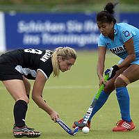 MONCHENGLADBACH - Junior World Cup<br /> Pool C: New Zealand - India<br /> photo: Lily Chanu Mayengbam (blue) and rachel McCann (black).<br /> COPYRIGHT FRANK UIJLENBROEK FFU PRESS AGENCY