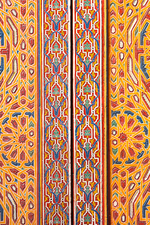 FEZ, MOROCCO - 16th DECEMBER 2015 - Close-up detail of intricately painted geometric patterns painted on doorways and walls of buildings in the old Fez Medina, Middle Atlas Mountains, Morocco.