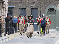 © Licensed to London News Pictures. 12/09/2017. London, UK. Extras, cast and crew members are seen as new television series 'Vanity Fair' is filmed in Sptalfields in London. The mini series is being made for ITV and Amazon Prime and stars Tom Bateman and Michael Palin. Photo credit: Graham Long/LNP