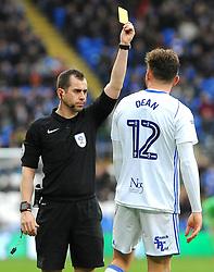 Paul Barnes shows a yellow card to Harlee Dean of Birmingham City - Mandatory by-line: Nizaam Jones/JMP - 10/03/2018 -  FOOTBALL -  Cardiff City Stadium- Cardiff, Wales -  Cardiff City v Birmingham City - Sky Bet Championship