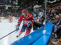 KELOWNA, CANADA - MARCH 7: Jordan Henderson #8 of Spokane Chiefs checks Tyson Baillie #24 of Kelowna Rockets into the boards on March 7, 2015 at Prospera Place in Kelowna, British Columbia, Canada.  (Photo by Marissa Baecker/Shoot the Breeze)  *** Local Caption *** Tyson Baillie; Jordan Henderson;