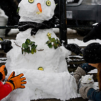 Richmond - England  Feb 2nd  A snow man with his white cat. The snow which crippled South East England this morning will stay with the UK for the rest of the week, forecasters warn,...***Standard Licence  Fee's Apply To All Image Use***.Marco Secchi. tel +44 (0) 845 050 6211. e-mail ms@msecchi.com .www.marcosecchi.com