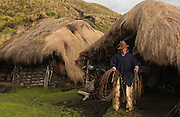 Ecuadorian Chagra (Cowboy) Manuel Changoluisa at his home which is a traditional Chagra sod hut<br /> Paramo (High Andean Grasslands)<br /> Base of Cotopaxi Volcano, Andes<br /> ECUADOR.  South America