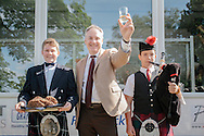 Royal Highland Show, 2014. Halls reclaim World's largest haggis record at the `Highland Show. 15 year old Cameron Hill from Kilmarnock, son of Browns Food Group  and 14 year old piper Cameron Forest from Biggar with Richard Lochhead Cab. sec. PAYMENT TO CRAIG STEPHEN 07905 483532