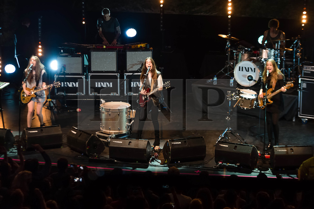 © Licensed to London News Pictures. 09/12/2013. London, UK.   Haim performing live at The Forum.In this pic - Alana Haim (left), Danielle Haim (centre), Este Haim (right).  Haim is an American indie rock band consists of sisters Este Haim (bass/vocals), Danielle Haim (guitar/vocals) and Alana Haim (guitar/vocals/keyboards) with drummer Dash Huttong<br /> <br /> Haim were nominated in the Brand New for 2013 category in the 2013 MTV Music Awards, and won the Sound of 2013 category in the BBC Sound of 2013 awards. <br /> <br /> Photo credit : Richard Isaac/LNP