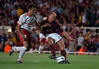 Photo: Henry Browne.<br /> Arsenal v FC Thun. UEFA Champions League.<br /> 14/09/2005.<br /> Dennis Bergkamp scores the winning goal for Arsenal.