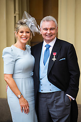 TV presenter Eamonn Holmes OBE with his wife Ruth Langsford after his investiture by HM The Queen at Buckingham Palace. London, June 01 2018.