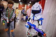 27 MAY 2011 - PHOENIX, AZ: GUNNER LLOYD (left) 12, and his brother GAGE LLOYD, 9, dressed as Star Wars characters at the Phoenix Comicon Friday. Phoenix Comicon opened Thursday and featured a Zombie Walk through downtown Phoenix Friday night. Hundreds of people participated in the Zombie Walk, both as Zombies and as Zombie hunters. This year's Comicon includes appearances by Leonard Nimoy (Star Trek), Adam Baldwin (Firefly and Chuck), Stan Lee (Marvel Comics), Nicholas Brendon (Buffy the Vampire Slayer) and others. Activities include costuming workshops, role playing games and a Geek Prom.     Photo by Jack Kurtz