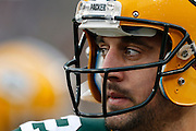 GREEN BAY, WI - DECEMBER 2:  Aaron Rodgers #12 of the Green Bay Packers looks toward the field during a game against the Minnesota Vikings at Lambeau Field on December 2, 2012 in Green Bay, Wisconsin.  The Packers defeated the Vikings 23-14.  (Photo by Wesley Hitt/Getty Images) *** Local Caption *** Aaron Rodgers Sports photography by Wesley Hitt photography with images from the NFL, NCAA and Arkansas Razorbacks.  Hitt photography in based in Fayetteville, Arkansas where he shoots Commercial Photography, Editorial Photography, Advertising Photography, Stock Photography and People Photography
