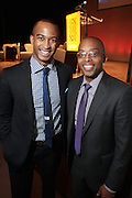 November 6, 2012- Harlem, NY:  (L-R) Author Dorian Warren and Dr. Khalil Gibran Muhammad, Director, The Schomburg Center at the U.S. Presidential Election Watch Party held at the Schomburg Center for Research in Black Culture on November 6, 2012 in Harlem, New York City. The Schomburg Center for Research in Black Culture, a research unit of The New York Public Library, is generally recognized as one of the leading institutions of its kind in the world. For over 80 years the Center has collected, preserved, and provided access to materials documenting black life, and promoted the study and interpretation of the history and culture of peoples of African descent. (Terrence Jennings)