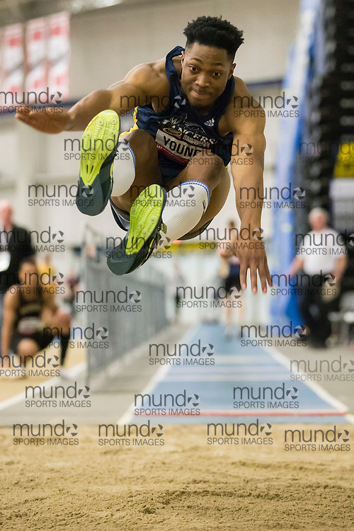 Windsor, Ontario ---2015-03-13--- Arren Young of Windsor competes in the long jump at the 2015 CIS Track and Field Championships in Windsor, Ontario, March 13, 2015.<br /> GEOFF ROBINS/ Mundo Sport Images