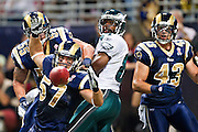 ST. LOUIS, MO - SEPTEMBER 11:   Chris Chamberlain #57 of the St. Louis Rams goes after a tipped pass thrown to Jason Avant #81 of the Philadelphia Eagles at the Edward Jones Dome on September 11, 2011 in St. Louis, Missouri.  The Eagles defeated the Rams 31 to 13.  (Photo by Wesley Hitt/Getty Images) *** Local Caption *** Chris Chamberlain; Jason Avante Sports photography by Wesley Hitt photography with images from the NFL, NCAA and Arkansas Razorbacks.  Hitt photography in based in Fayetteville, Arkansas where he shoots Commercial Photography, Editorial Photography, Advertising Photography, Stock Photography and People Photography