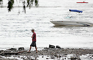 Cornwall-on-Hudson, New York - A man walks along the shore of the Hudson River during RiverFest at Donahue Park on June 4, 2011.
