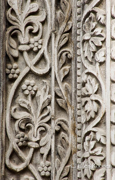 Intricate wood carving around the main door to the Dhow Palace Hotel in Stone Town, Zanzibar, Tanzania