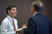 Jack Melick, left, student in the Schey Sales Centre, talks with his father, John Melick of Wells Fargo, an event sponsor, during a break at the 2016 Schey Sales Symposium held in Baker Center on November 3, 2016.