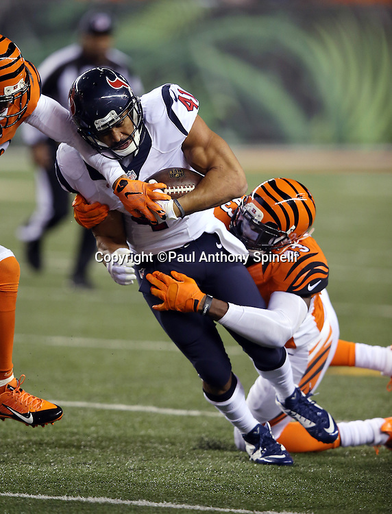 Houston Texans running back Jonathan Grimes (41) gets tackled by Cincinnati Bengals strong safety George Iloka (43) during the 2015 week 10 regular season NFL football game against the Cincinnati Bengals on Monday, Nov. 16, 2015 in Cincinnati. The Texans won the game 10-6. (©Paul Anthony Spinelli)
