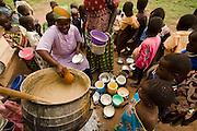 Women serve lunch for school children outside the Nyologu Primary School in the village of Nyologu, northern Ghana, on Wednesday June 6, 2007. The school feeding program here is sponsored by the World Food Programme.