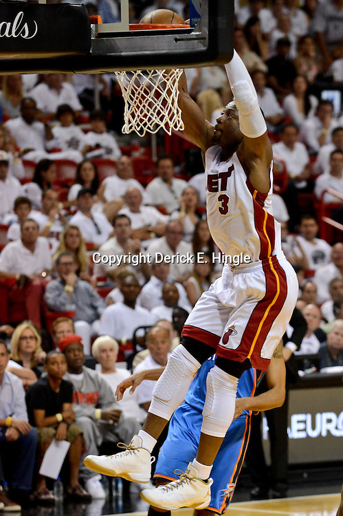 Jun 17, 2012; Miam, FL, USA; Miami Heat shooting guard Dwyane Wade (3) dunks against the Oklahoma City Thunder during the fourth quarter in game three in the 2012 NBA Finals at the American Airlines Arena. Miami won 91-85. Mandatory Credit: Derick E. Hingle-US PRESSWIRE